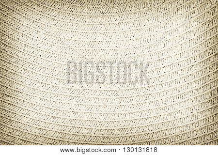 Woven straw background or texture. Brown colr.