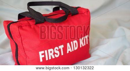A first aid kit bag in closeup against a neutral background.
