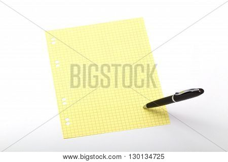 The photo of a dark ball pen which itself writes on a color squared paper