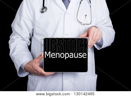 technology, internet and networking in medicine concept - Doctor holding a tablet pc with menopause sign. Internet technologies in medicine.