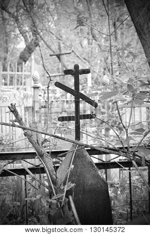 Iron cross on the very old cemetry, black and white photo poster