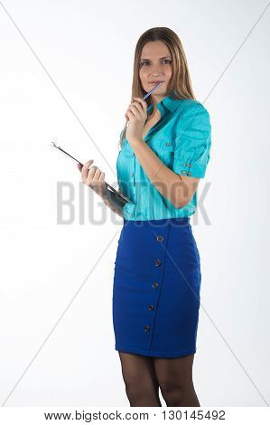 Businesswoman with long hair in blue isolated on a gray background