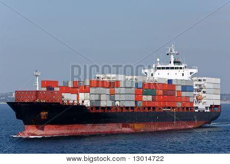 Container cargo ship at sea.