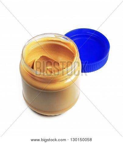 Peanut butter lid, isolated on white background. Unhealthy eating theme.