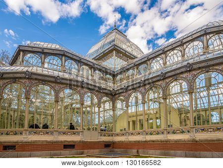 MADRID,SPAIN - APRIL 24,2016 - The Crystal Palace (Palacio de Cristal)is a glass and metal structure located in Madrids Retiro Park. It was built in 1887 to exhibit flora and fauna from the Philippines.