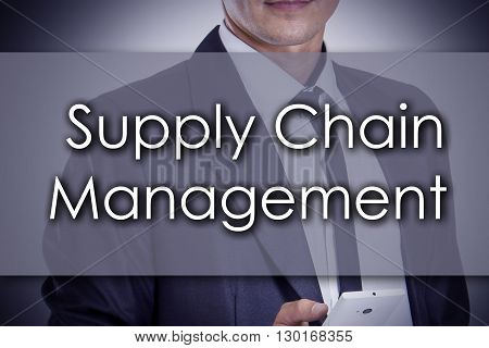 Supply Chain Management Scm - Young Businessman With Text - Business Concept