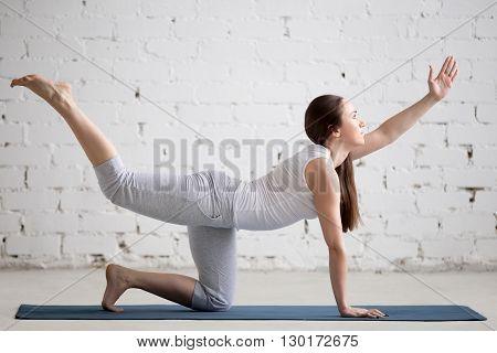 Portrait Of Beautiful Woman Doing Chakravakasana Pose