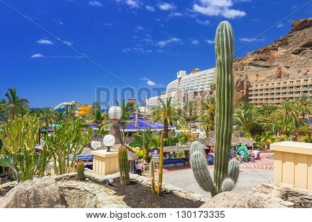 TAURITO, GRAN CANARIA, SPAIN - APRIL 20, 2016: Sun holidays at the pool of Paradise Lago Taurito hotel, Gran Canaria. Paradise is a complex of 4 hotels in Gran Canaria.