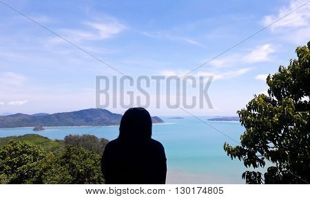 Girl Silhouette wite High angle view sea sky and seaside tourist town of Ao Chalong bay from Khao-Khad mountain viewpoint famous attractions in Phuket island Thailand