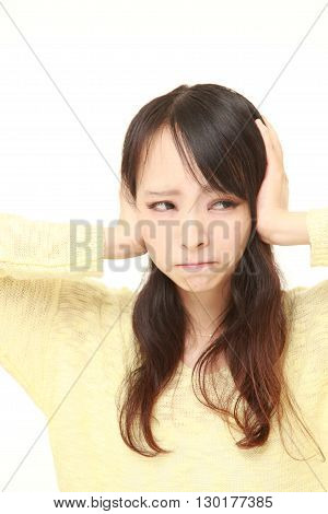 portrait of Young Japanese woman suffers from noise on white background