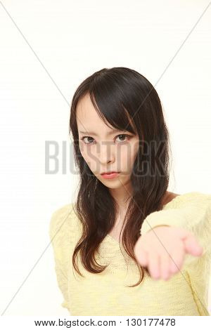 portrait of angry young Japanese woman requests something on white background