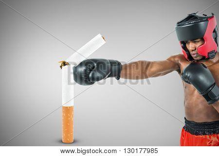 Boxer performing upright stance against grey vignette