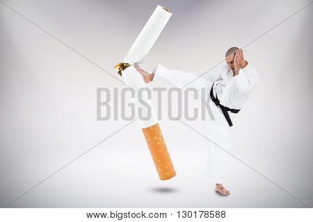 Fighter performing karate stance against grey background