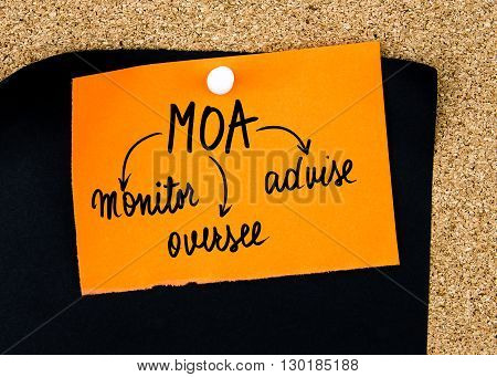 Business Acronym Moa As Monitor, Oversee, Advise Written On Orange Paper Note