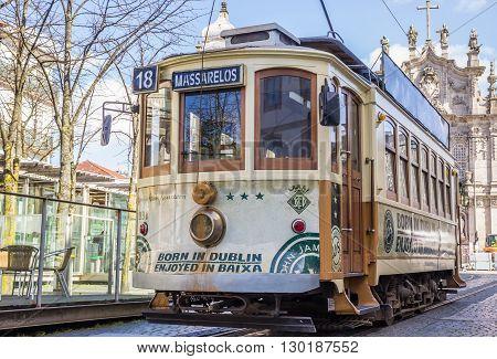 PORTO, PORTUGAL - APRIL 20, 2016: Streetcar in front of a church in Porto, portugal