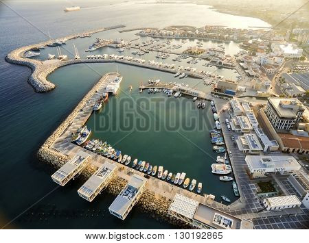 Aerial view of fishing boats docked at the Limassol old port (palio limani) in Cyprus next to the Marina part of the ports authority. A view of the harbor the mediterranean sea the water boat and fish nets and fishing equipment.
