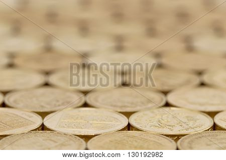 British money pound coins background laid flat with very shallow depth of field..