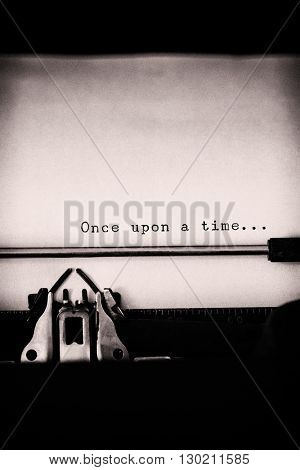 Once upon a time message on a white background against close-up of typewriter