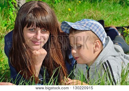 Woman And Child Playing On Green Grass
