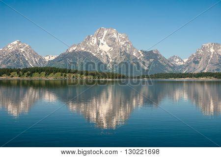 The Teton Range reflected in the Jackson Lake Grand Teton National Park