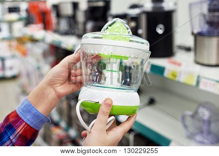 Electric Juicer In Hands Of Buyer At Store
