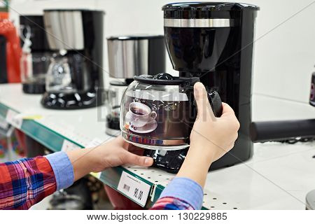 Buyer Chooses Coffee Machine In Store