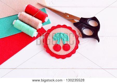 Colorful felt brooch. Brooch felt embroidery. Brooch with felt cherries. Summer kids crafts. Sheets of felt, scissors, thread, needle - sewing kit