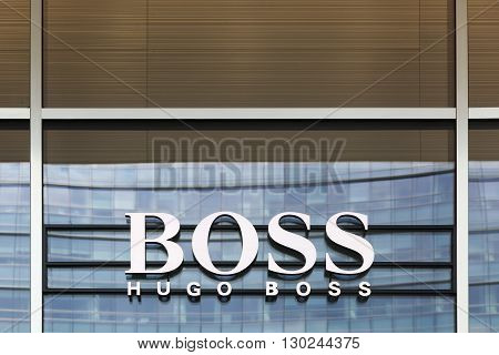 Milan, Italy - April 15, 2016: Hugo Boss sign on a store. Hugo Boss is a German luxury fashion house. It was founded in 1924 by Hugo Boss and is headquartered in Metzingen, Germany