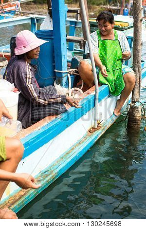 KOH CHANG - THAILAND - CIRCA DEC, 2015: Unidentified locals in fisherman's village. Island is on Gulf of Thailand, near border with Cambodia, population of 5356 people living in 8 villages.