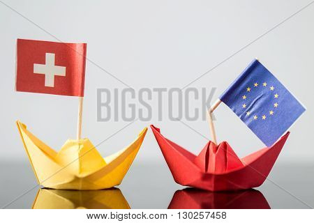 Paper Ship With Swiss And European Flag