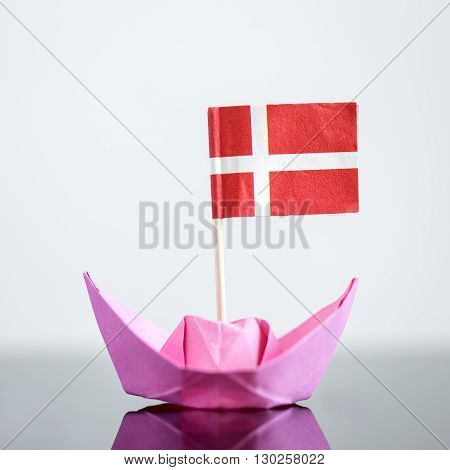 paper ship with danish flag concept shipment or free trade agreement poster