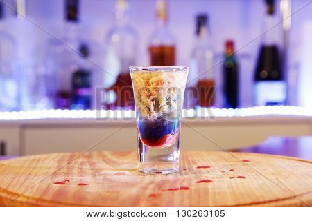 alcoholic drinks shot on a wooden board