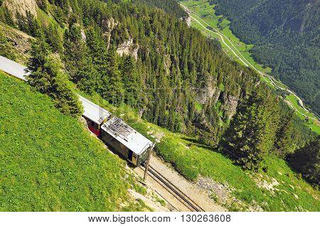 Retro passenger train moves from Schynige Platte to Interlaken. Switzerland.