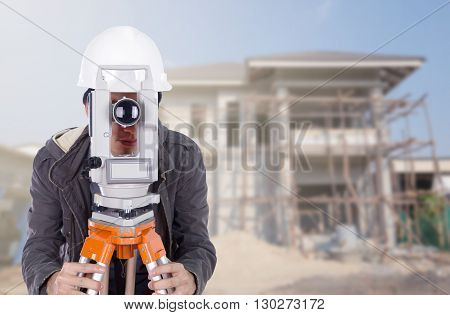 Engineers Use Tacheometer Or Theodolite With Building Construction Site