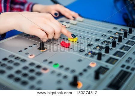 Professional audio mixing console with faders and adjusting knobs - radio poster