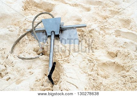 Anchor on white sand at the beach