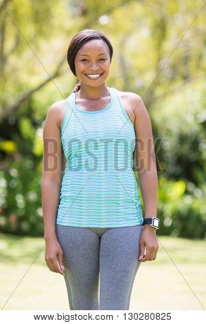 Happy woman posing at park