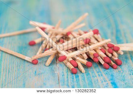 Matchsticks over on old vintage wooden background