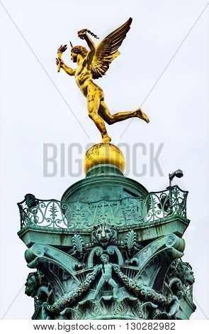 PARIS, FRANCE - MAY 31, 2015 Genie de La Liberty by Dumont Bastile Square Place de la Bastille famouse meeting place Paris France. Location of Bastile prison which was stormed and destroyed in 1789 in the Frence Revolution. July column commemorates events
