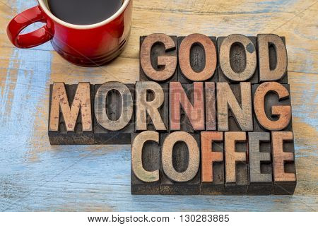 Good morning coffee banner in vintage letterpress wood type blocks with a cup of coffee