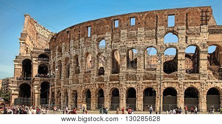 ROME ITALY - APRIL 7 2016: Tourists visiting the Colosseum on APRIL 7 2016 in Rome Italy. The Colosseum is a major tourist attraction in Rome