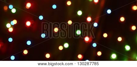 colorful saturated dots neon abstract background over dark