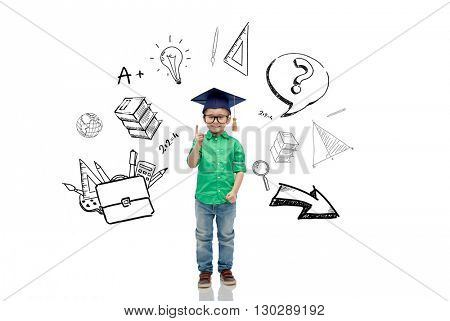 childhood, school, education, knowledge and people concept - happy boy in bachelor hat or mortarboard and eyeglasses pointing finger up with doodles
