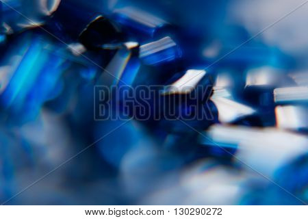 Abstract shiny blue sapphire background. Blurred. Background. Texture.