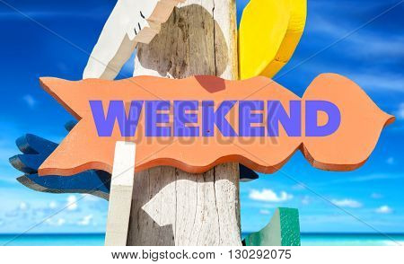 Weekend signpost with beach background