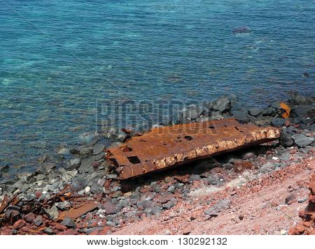 Rusted ship wrack abandoned at the coast