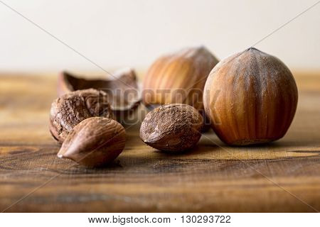 macro hazelnut and nutshell on wood dried fruit