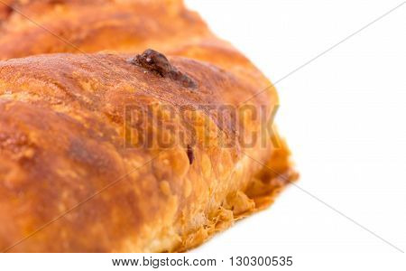 Delicious puff pie stuffed with chicken breast. Closeup of pie crust. Macro. Photo can be used as a whole background.
