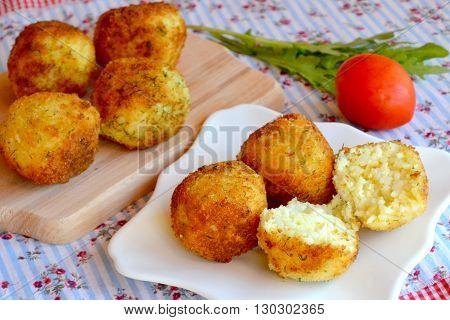 Arancini - fried rice balls. Fried rice cutlets recipe.