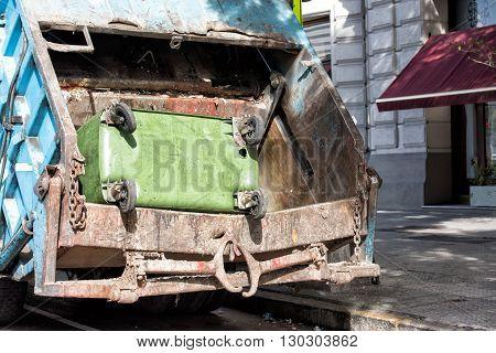 Rubbish Container In A Rubbish Truck